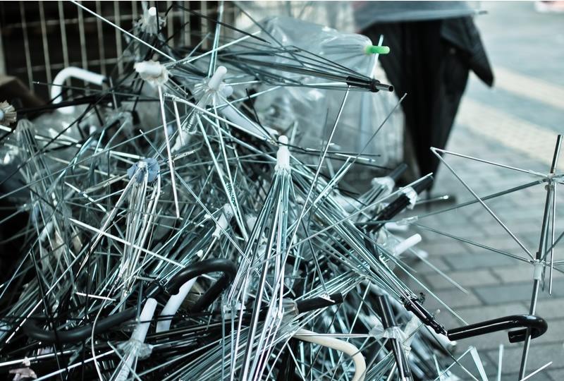 A pile of broken umbrellas